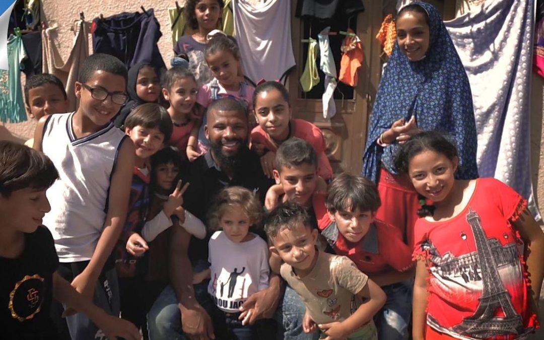 'PEOPLE'S CHAMPION' Two-weight king Badou Jack visits Al Baqaa refugee camp in Jordan